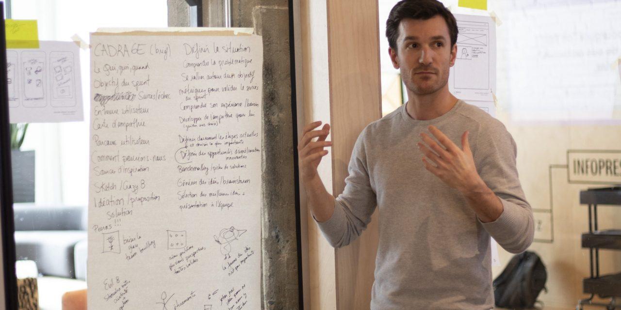 Photograph of a man explaining his ideas during a Design Sprint