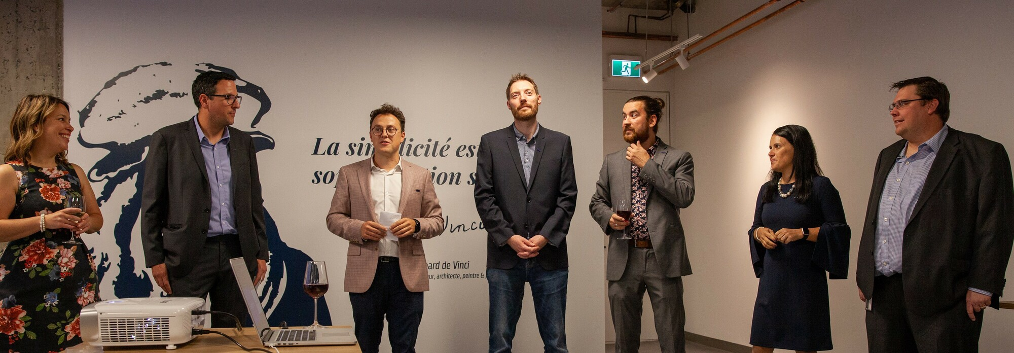 Photographie des membres de la direction de Libéo prise lors des discours d'inauguration du nouveau bureau de Montréal